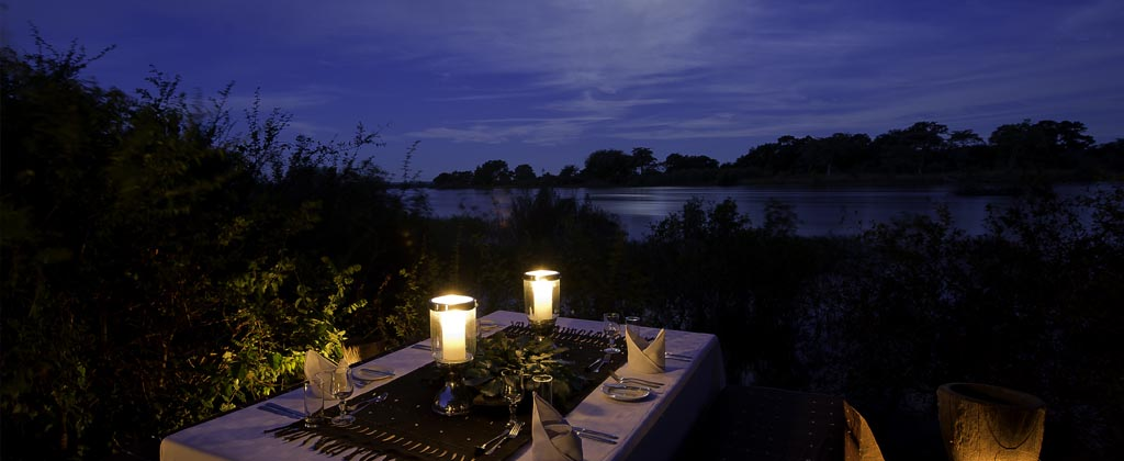 Lanterns and candlelight provide the perfect atmosphere to enjoy a dinner next to the Zambezi River