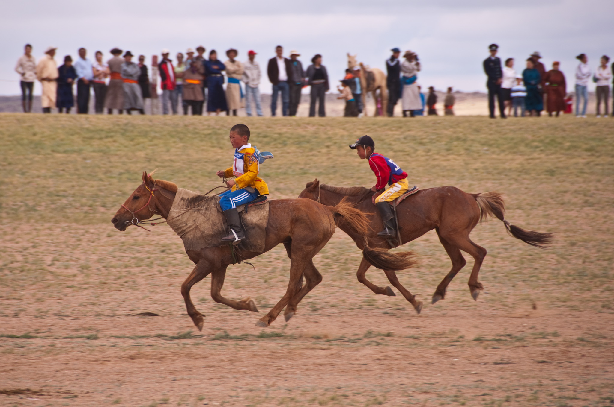 Two young riders race across the finish line (image courtesy of Mark Fischer)