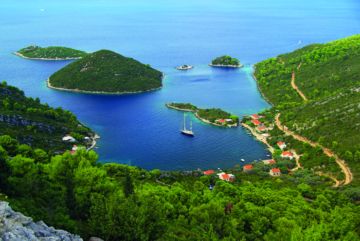 Top 10 cruise journeys - A boat pulling into the small village Planjak, island Mljet