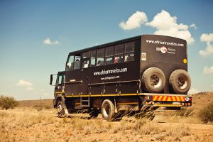 Big truck - overland camping vs lodge-accommodated safaris in Africa