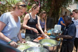 Group preparing lunch on an overland camping safari