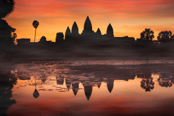 View of Angkor Wat at Sunrise from across the reflection ponds