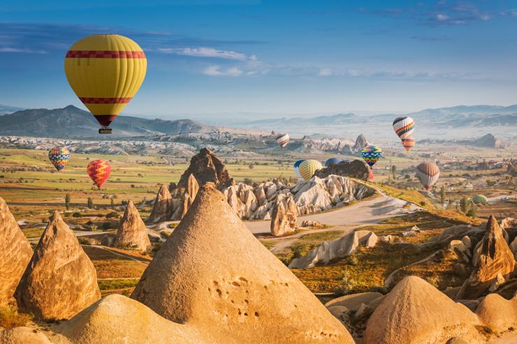 Hot air balloons flying over Cappadocia in Turkey