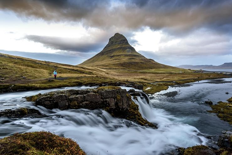 Rugged landscape of Iceland at Kirkjufellsfoss Waterfall and Kirkjufell mountain