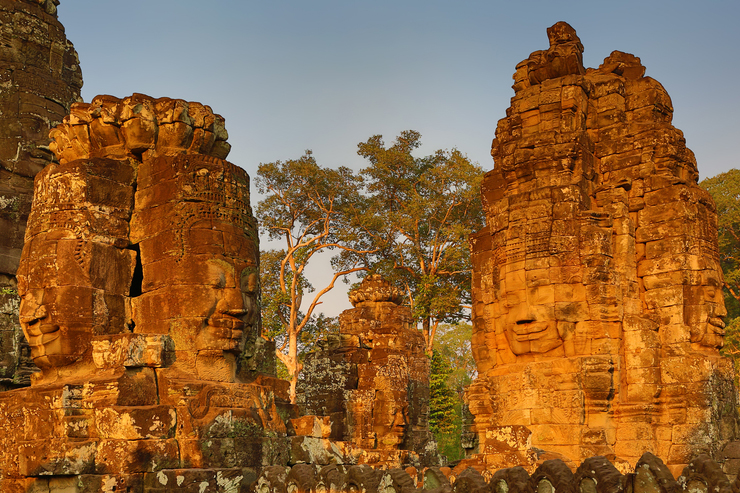Stone faces at the Bayon temple, one of the best spots in Angkor to watch sunrise and sunset