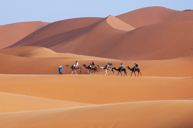 Camel trek in the Sahara desert of Morocco, one of the best family holiday destinations