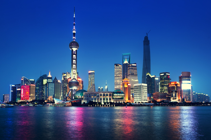 Shanghai's skyline reflected on the river Yangtze at night