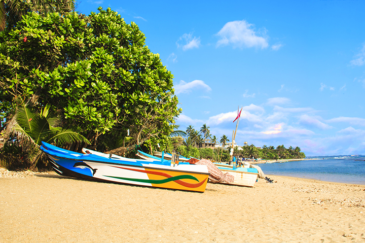 Bright boats on the tropical beach of Bentota, Sri Lanka