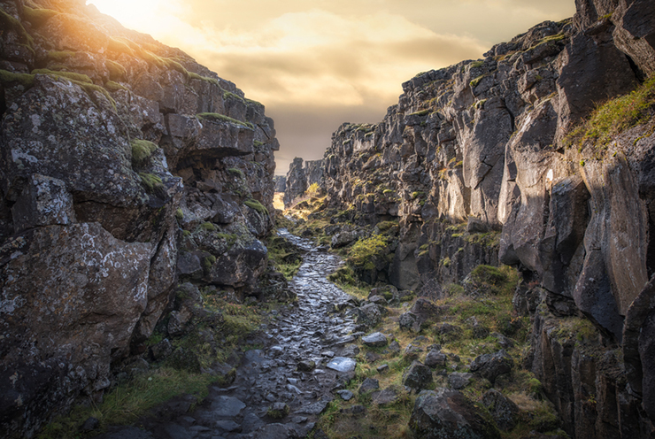 Beautiful stone pathway at Thingvellir National Park in Iceland at sunset