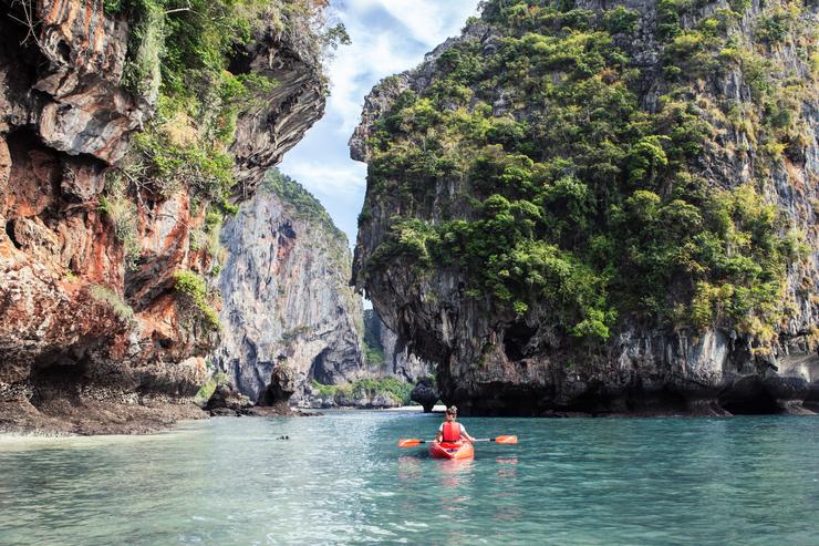 Female kayaking in Halong Bay, Vietnam