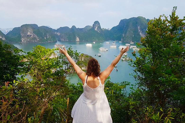 Solo female traveller overlooking Halong Bay, Vietnam