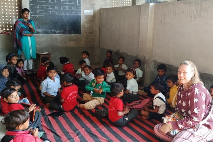 Traveller in classroom of local school in India