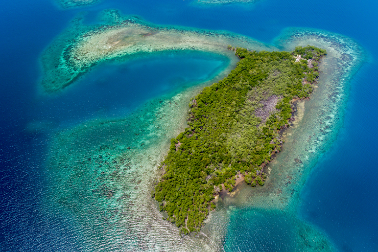 An aerial image of various cayes and coral reefs off the coast of Belize