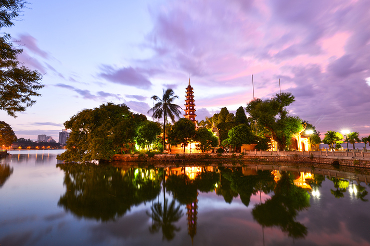 Sunset of Tran quoc pagoda in ho tay west lake of hanoi, vietnam