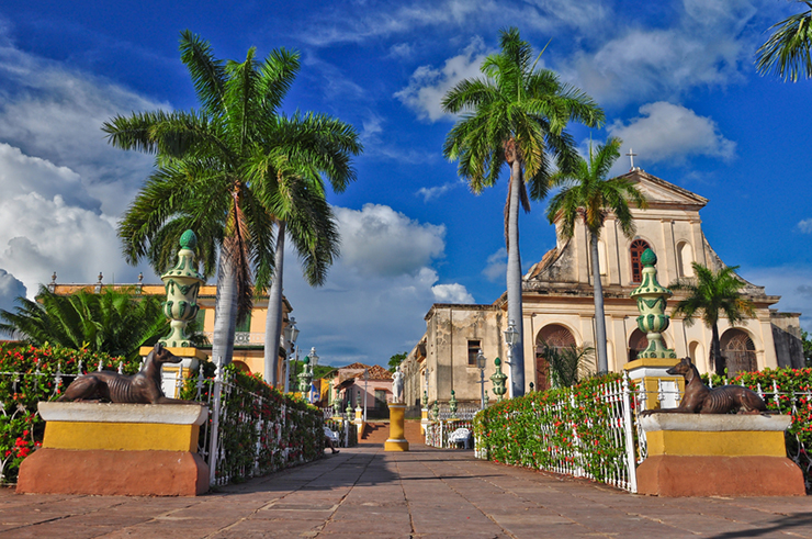 Palm trees and colonial architecture in Trinidad, Cuba