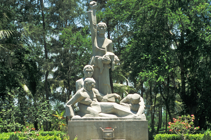 White stone memorial statue to the victims of the My Lai Massacre, Vietnam.