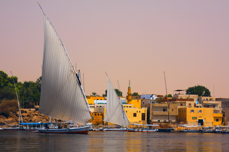 Felucca with houses in background