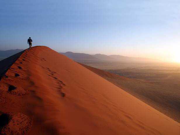 Orange sand dunes stretching into the distance at Sesriem