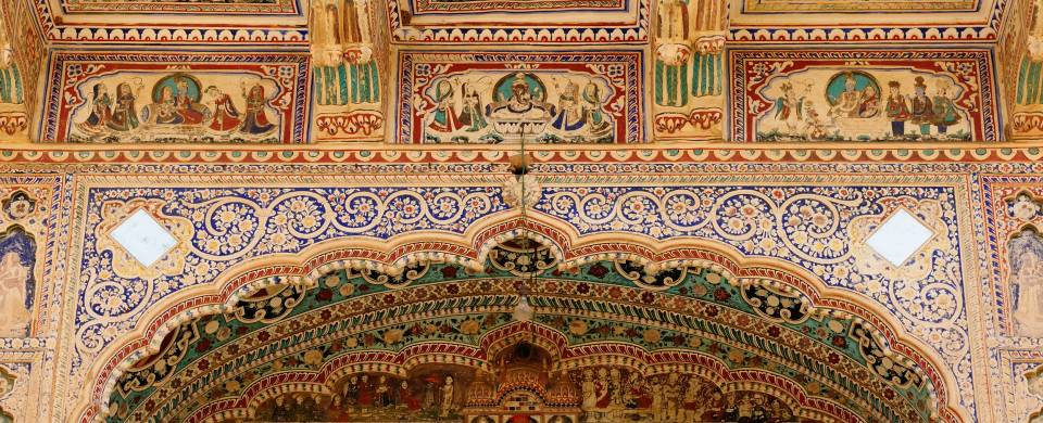 Intricate fresco on the inside walls of a haveli in Alsisar