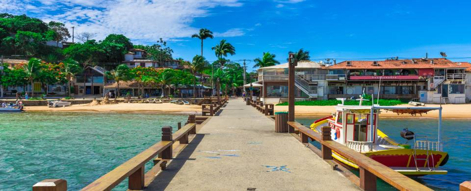 Boardwalk over crystal clear blue water in Amacao Dos Buzios