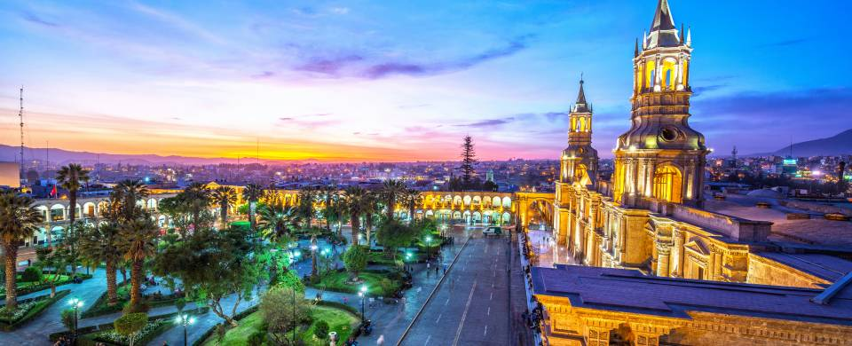 Main plaza in Arequipa sparkling with bright lights at night