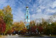 The towering spire of the Ascension Church surrounded by attractive parkland in Yekaterinburg