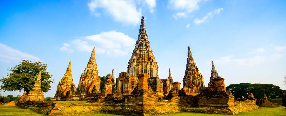 Ancient temples against a bright blue sky in Ayutthaya