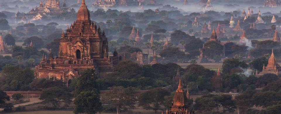 Temples of Bagan at dawn, surrounded by wisps of cloud