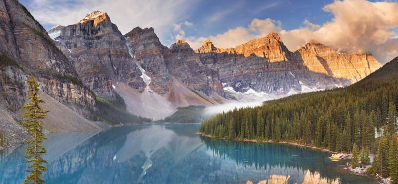 A dazzling blue lake backed by snow-capped mountains in the Banff National Park