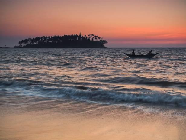 Traditional Sri Lankan boat on the sandy beach in Bentota and Beruwala