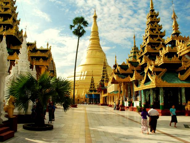 People walking around at the famous temple in Yangon