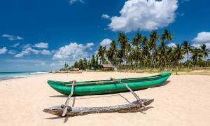 Boat on the beach in Trincomalee - Sri Lanka Tours - On The Go Tours