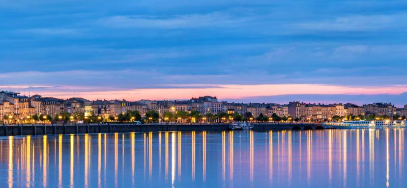 Panoramic view of Bordeaux city at dusk