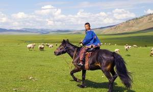 Boy riding horse - Trans-siberian Railway Journeys - On The Go Tours