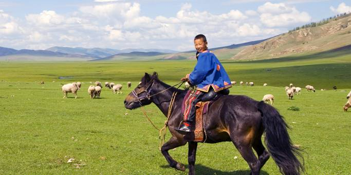 Boy riding horse in the countryside | Trans Siberian Railway