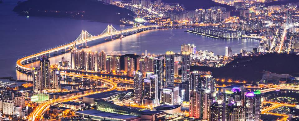 Aerial view of the cityscape in Busan, lit up at night