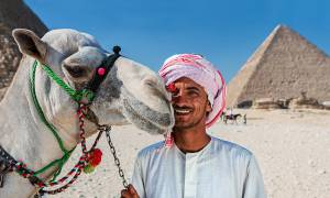 Camel man and Pyramids of Giza - Egypt Tours - On The Go Tours