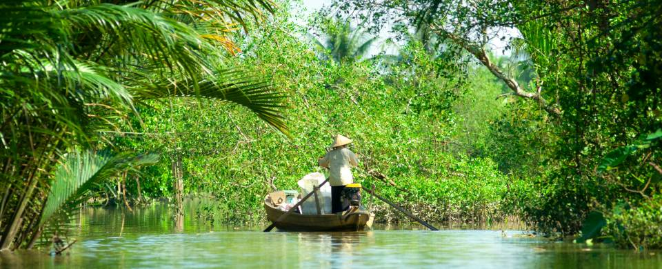 Boat making its way along the Mekong Delta near Can Tho