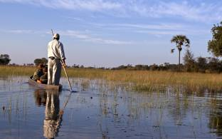 Canoe safari in a traditional mokoro - Okavango Delta - Botswana