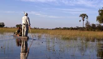 Canoe safari in a traditional mokoro - Okavango Delta - Botswana