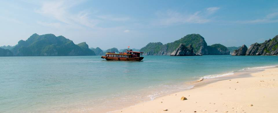 The stunning beach of Cat Ba Island with other islands in the background