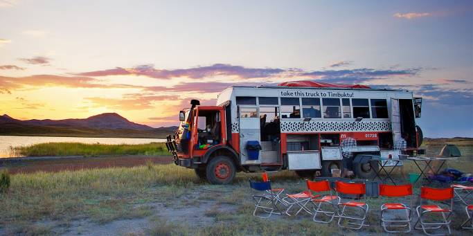 Overland truck at lakeside campsite | Central Asia