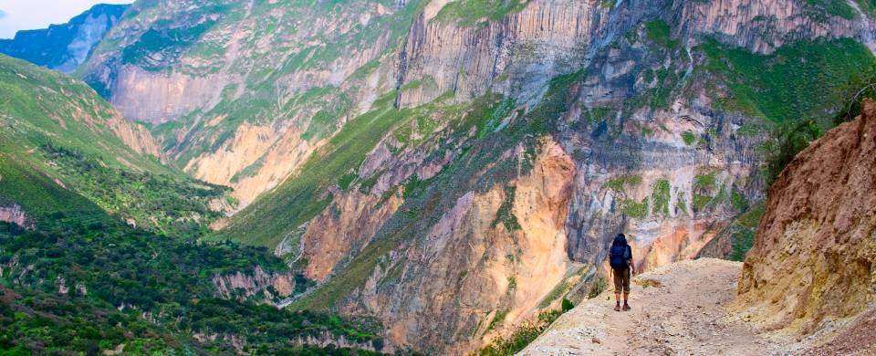 Man standing at the edge of a cliff in the Colca Canyon