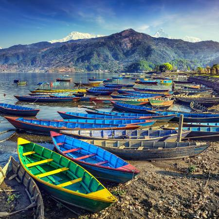 Colourful boats on Lake Phewa in Pokara - Nepal Tours - On The Go Tours