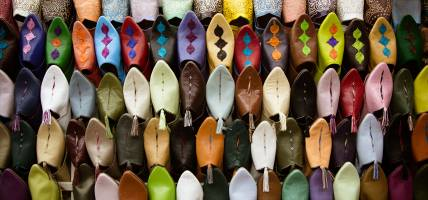 Colourful shoes in a Fes market - Morocco Tours - On The Go Tours