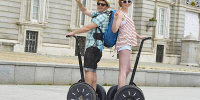 A couple of tourists riding a Segway in Madrid, Spain