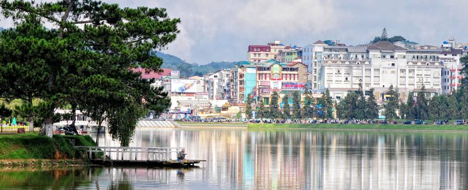 The gorgeous cityscape of Dalat being reflect off of the shimmering water