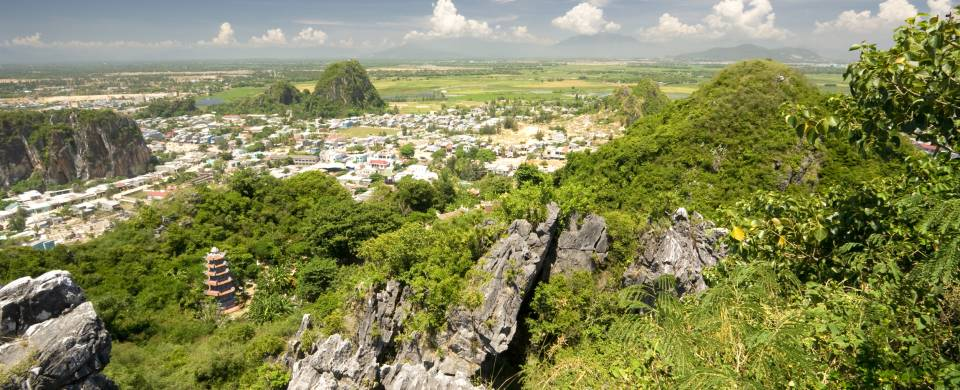 Rolling mountains covered in lush grass near the centre of Danang