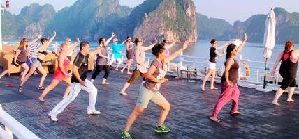 Doing Tai Chi on deck in Halong Bay - Vietnam Tours - Southeast Asia Tours - On The Go Tours