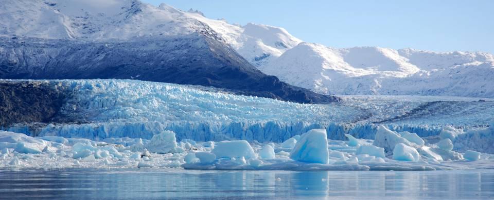 Impressive Perito Moreno glacier surrounded by snowy mountains in El Calafate